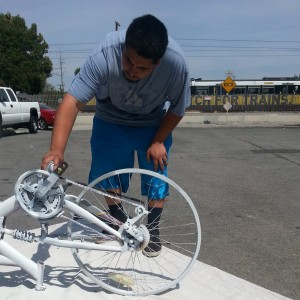 Ghost bike being prepared for Adrian Chavez Jr; photo by Danny Gamboa.