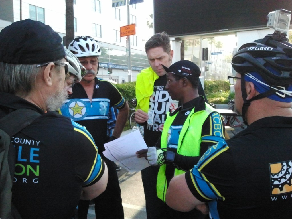 The ride marshals gathered before the start to discuss the routes and keeping the participants safe on streets that were shared with cars.